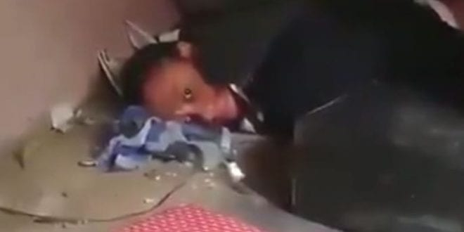 woman hides under bed