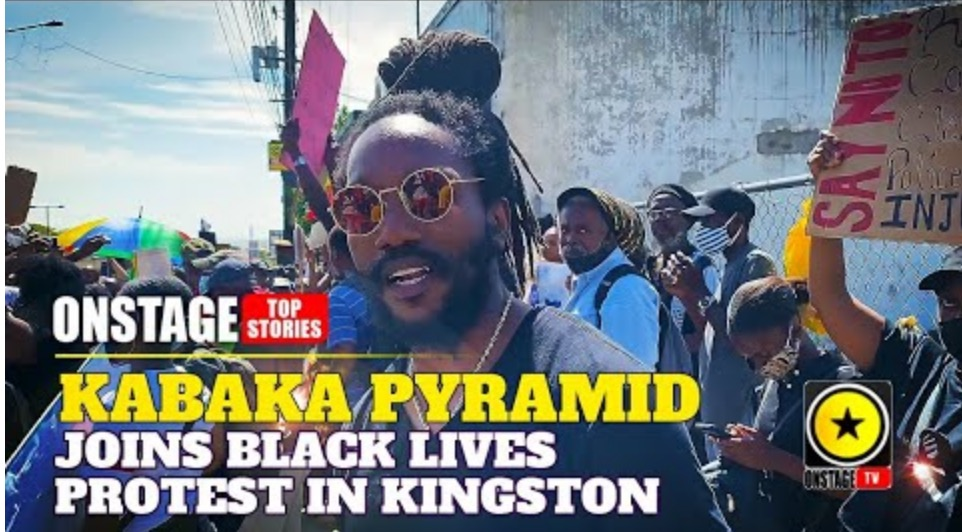 Photo of Kabaka Pyramid Stands With Black Lives Matter Protester In Kingston outside US Embassy